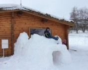Snow Fun at the Log Cabins