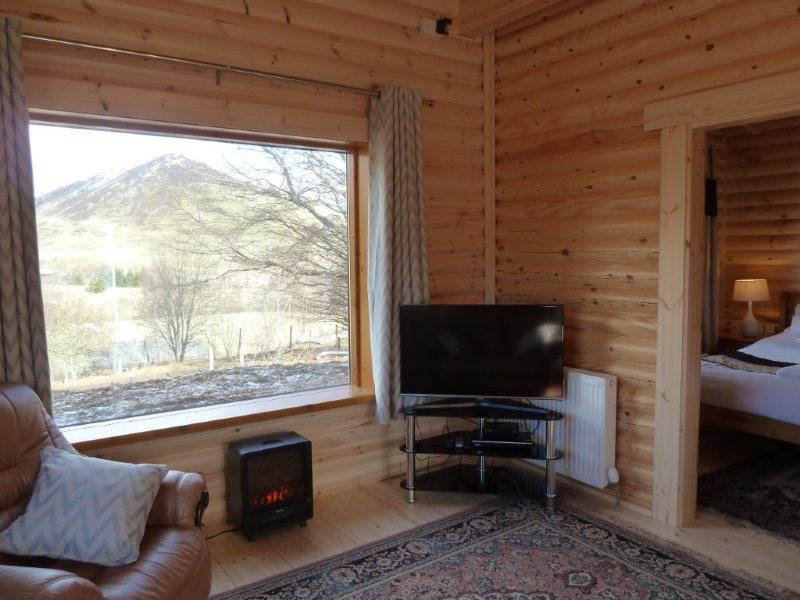 New log cabin april discount glenbeag mountain lodges for Log living room