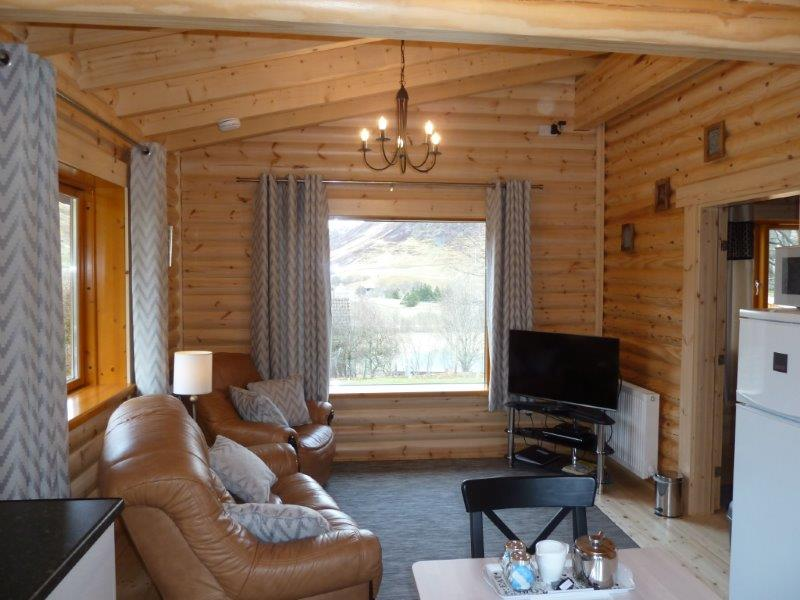Scotsview log cabin living room glenbeag mountain lodges for Log living room
